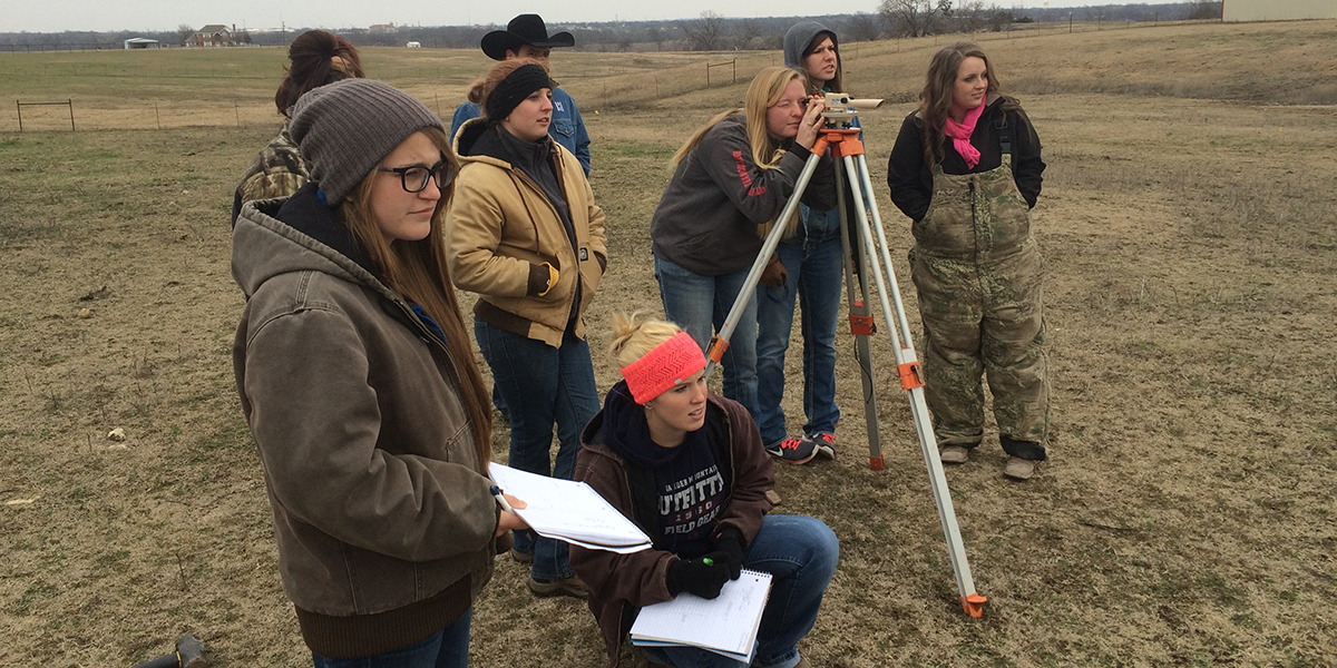 Students surveying the land for a farm or ranch
