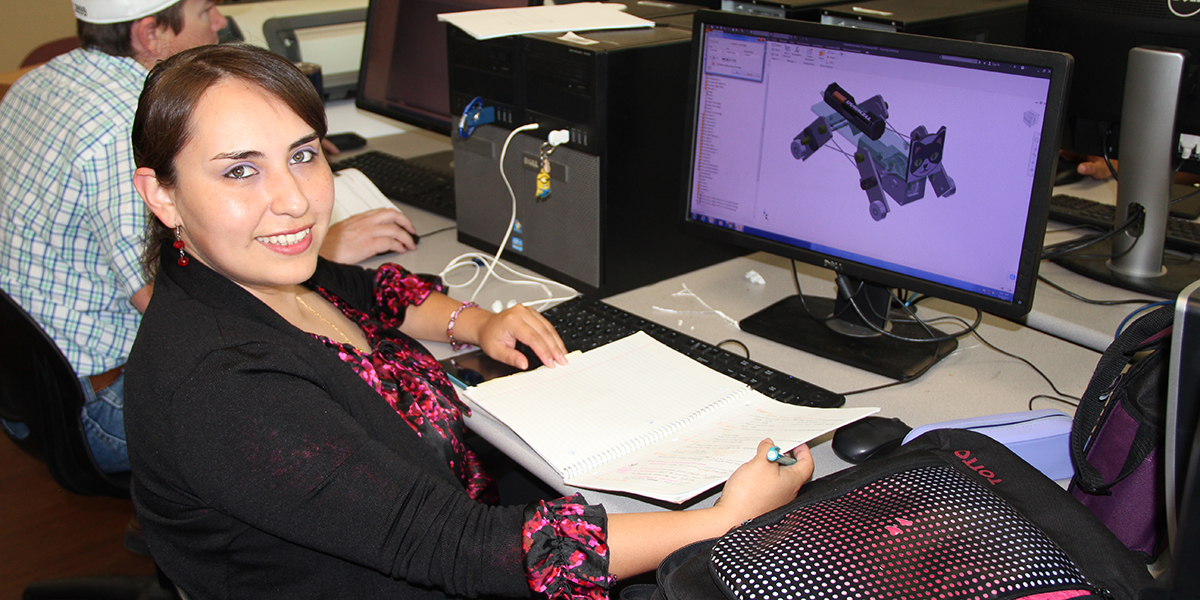 Female drafting student designing in CAD