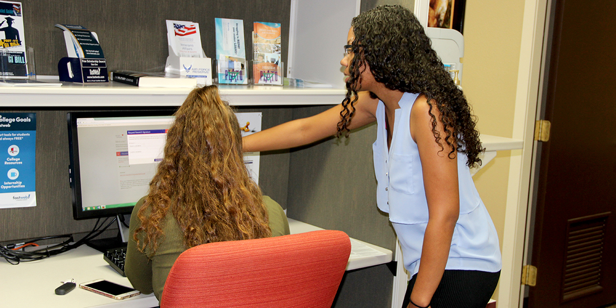 Financial Aid staff assisting a student