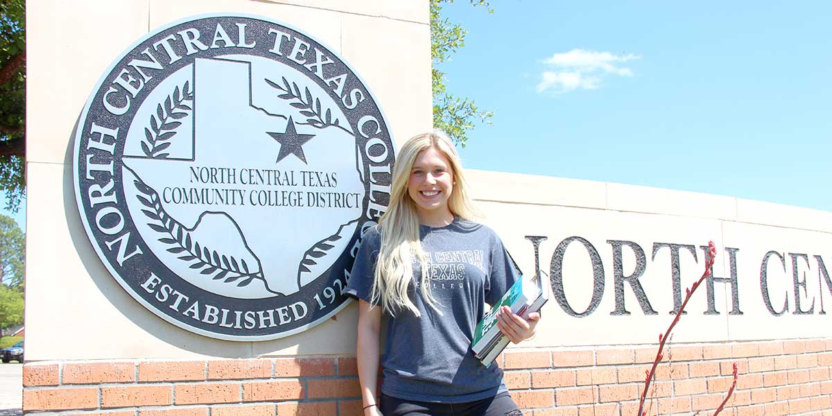 Student in Front of Graham's NCTC Seal