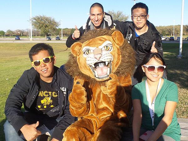 Students hang out with Leo the Lion.